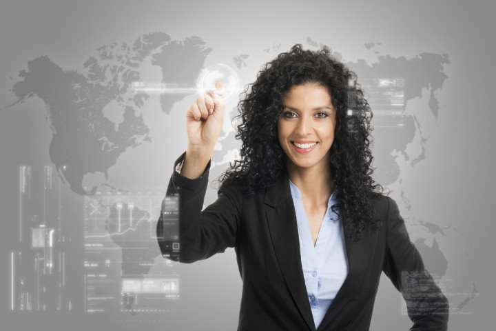 Businesswoman touching a digital control panel